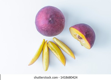 Top view of a soft composition, nectarines. A whole nectarine, a half nectarines with four slices. Really juicy and organic fruit.