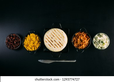 Top view of South American food called arepa and different ingredients