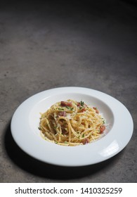 Top view of Spaghetti Carbonara in dark photography style.