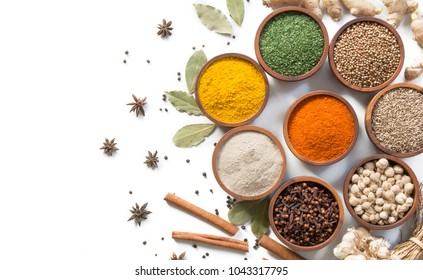 top view spices and herbs in wooden bowl on white background