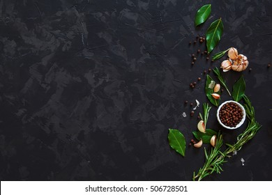 Top view of spices on dark vintage background.