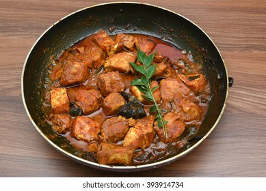Top view of Spicy King Fish Curry / Kerala fish curry close up, Traditional Asian fish curry dish in a pan, seasoned with curry leaf, India