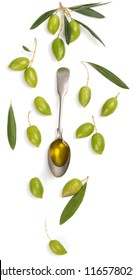 Top view of spoon with olive oil, twig of olive tree and green olives fruits isolated on white background.