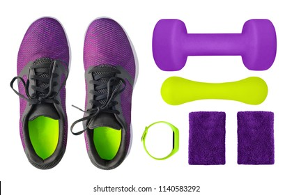 Top view of sport accessories and equipment for fitness and weight lifting. Training shoes, dumbbells, fitness bracelet and wristbands isolated on white background. Healthy lifestyle concept