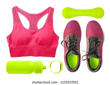 Top view of sport and fitness accessories and clothing for women. Running shoes, training bras, water bottle etc. isolated on white background