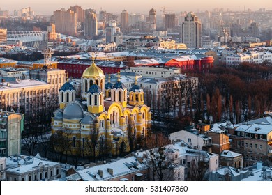 top view of St. Vladimir's Cathedral and the old city in Kiev, Ukraine at evening in winter.