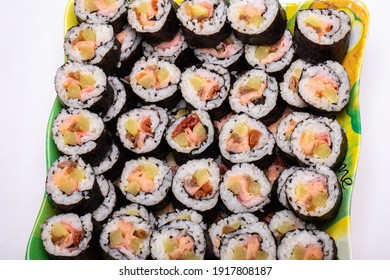 Top view of stack of Japanese sushi maki roll plate. Served in Japanese bar restaurant with chopstick