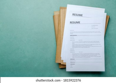 Top view of stack of office documents and cv forms on the desk.Empty space