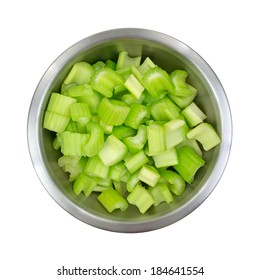 Top view of a stainless steel bowl filled with chopped celery on a white background.