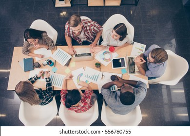 Top view of start-up multinational group of creative people having meeting