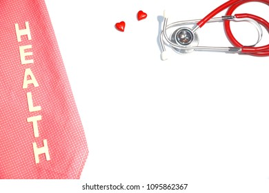 """Top view of Stethoscope, mini red hearts and wood word """"HEALTH"""" on white background. Health care Medical concept. Copy space. Can be use for brochure, advertising, banner."""