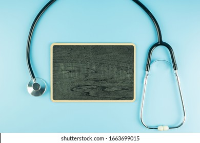 Top view Stethoscope on blue background with copy space for text. Healthcare, life Insurance, Health day, World Heart Day and Happy Doctor day concept