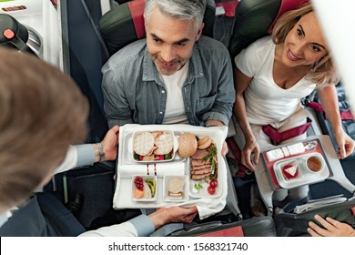 Top view of stewardess holding food tray in plane stock photo