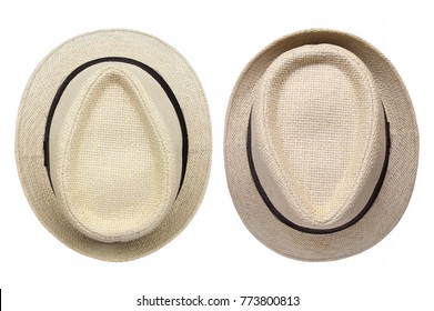 Top view of straw hats isolated on white background.