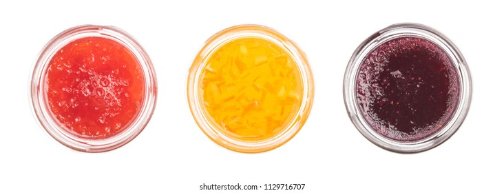 top view strawberry, orange and blueberries jam on a white background