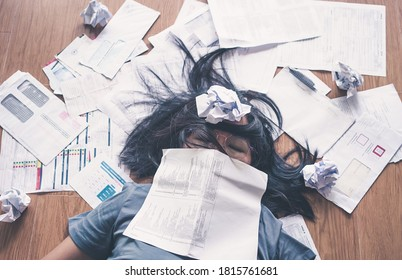 Top view of stressed asian woman worry about the debts and bills.