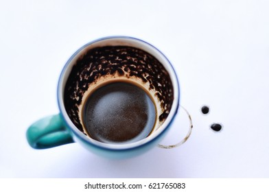 Top view to structure of turkish coffee grounds in small blue cup. Version with coffee drops.