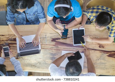 top view of students do homework and talking