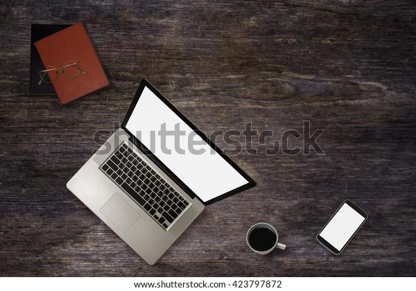 Top view of stuff office desktop