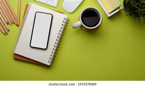 Top view of stylish flat lay workspace with smartphone, stationery and coffee cup on the table, clipping path