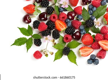 Top view of summer berries and fruits (strawberry, raspberry, blueberry, blackberry and cherry) with flowers and leaves isolated on white background.