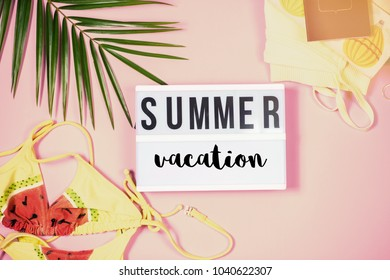 Top view summer vacation beach accessories on pink pastel background