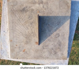 Top View Of Sundial. sundial is a device that tells the time of day when there is sunlight by the apparent position of the Sun in the sky.