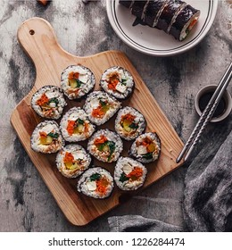 Top view of sushi.Sushi is a Japanese dish of specially prepared vinegared rice  usually with some sugar and salt, combined with a variety of ingredients