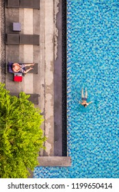 top view of swimming pool , man is swimming in pool , Vacation concept , Relaxing