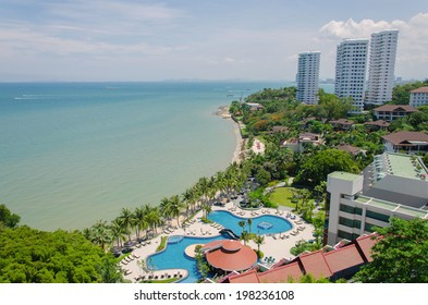 Top view of Swimming pools at tropical beach in luxury hotel