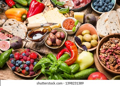 Top view table full of food. Italian antipasti wine snacks set over wooden background