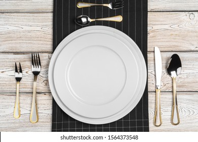 Top view of table setup on dark wooden background