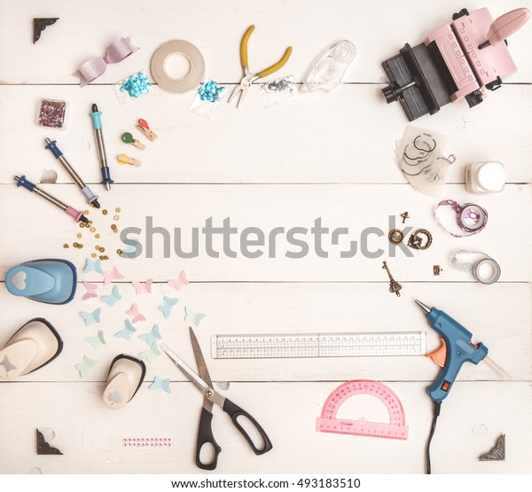 top view of the table with tools for scrapbooking