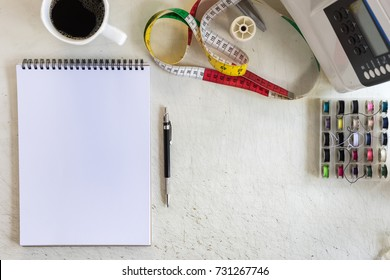 top view of tailor working desk. note book for sketch drawing design fashion. space for text