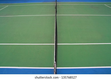 top view tennis court ,tennis ball on green blue court and net in sport competition background, sport club