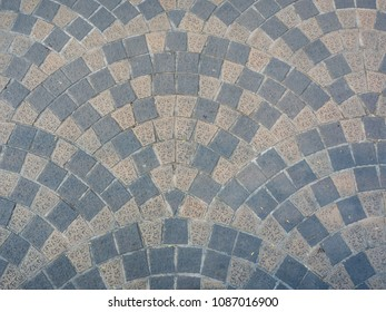 Top view of Thailand footpath tiles. - Cobble Eath tone stone arrange as wave.