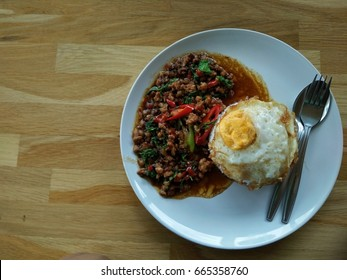 Top view, Thailand traditional food and most popular menu for foreigners, Pad Kra Pao Kai Dow.Fried pork with basil leaves and star egg.
