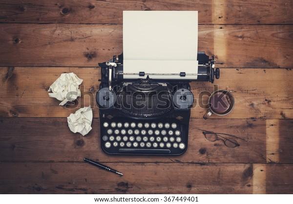 Top view thirties retro writers desk with typewriter