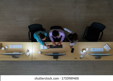 Top view of Three Asian customer care service working hard late in night shift at office,call center department,worker and overtime,team work with colleagues for success concept