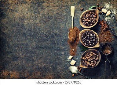 Top view of three different varieties of coffee beans on dark vintage background