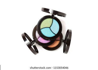 Top view of Three Eye shadows pallets isolated on white. Fashion cosmetic set. Top view. Emty space for text. Copyspace