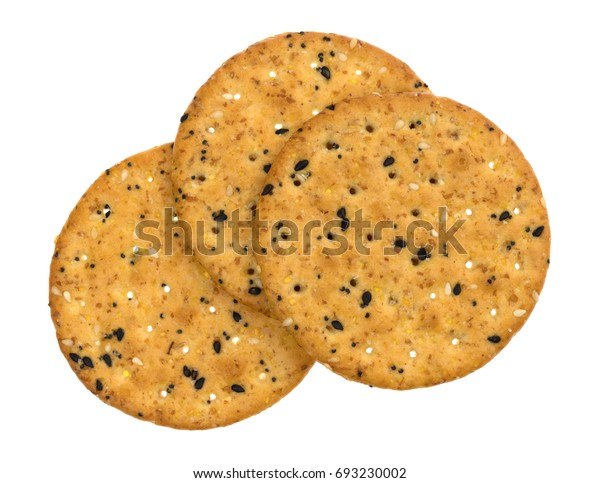 Top view of three multi grain baked crackers isolated on a white background.