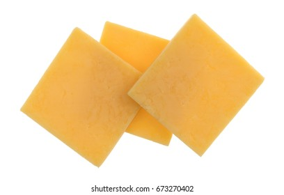 Top view of three slices of gouda cheese isolated on a white background.