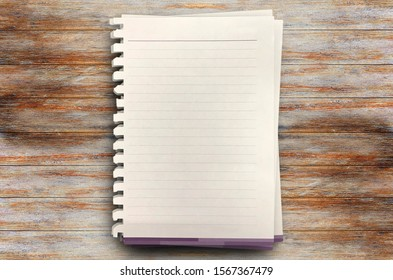 Top view with three white paper on wood table in office workplace. Blank Pad of Paper ready for your text and new idea.