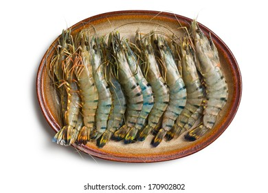 top view of tiger shrimps on ceramic plate