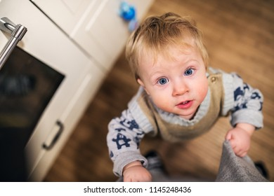 Top view of a toddler boy looking up at home. Close up.