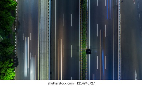 Top view of toll road with light trails of vehicle at night time in Jakarta, Indonesia