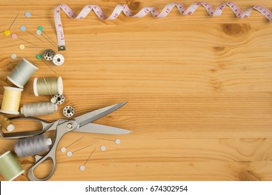 top view of tools for handicraft sewing on wood texture, space for input text