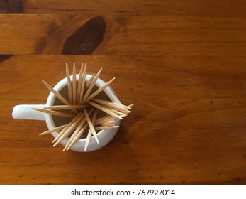 Top view of toothpick in small jug.
