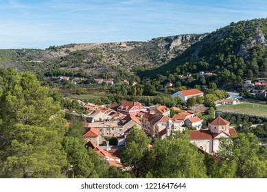 Top view of the town of Skradin in Croatia, mountains, forest and sky